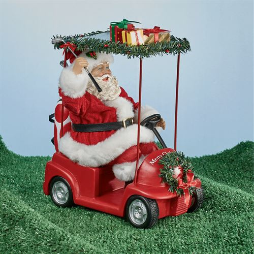 on the green fabriche santa figurine red