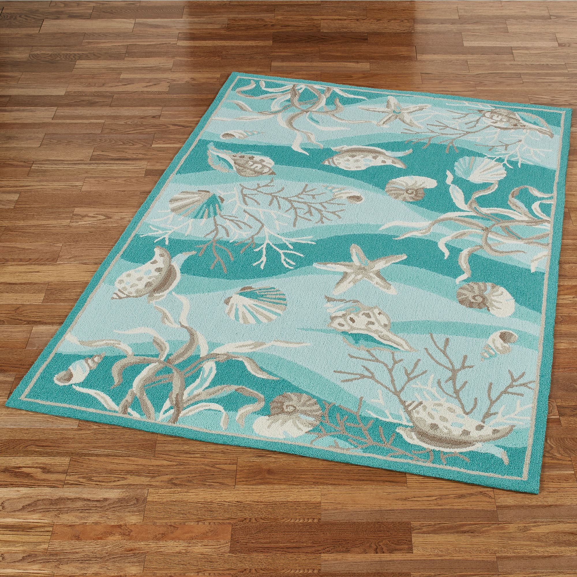 Hidden Treasures Teal Ocean Seashell Area Rugs