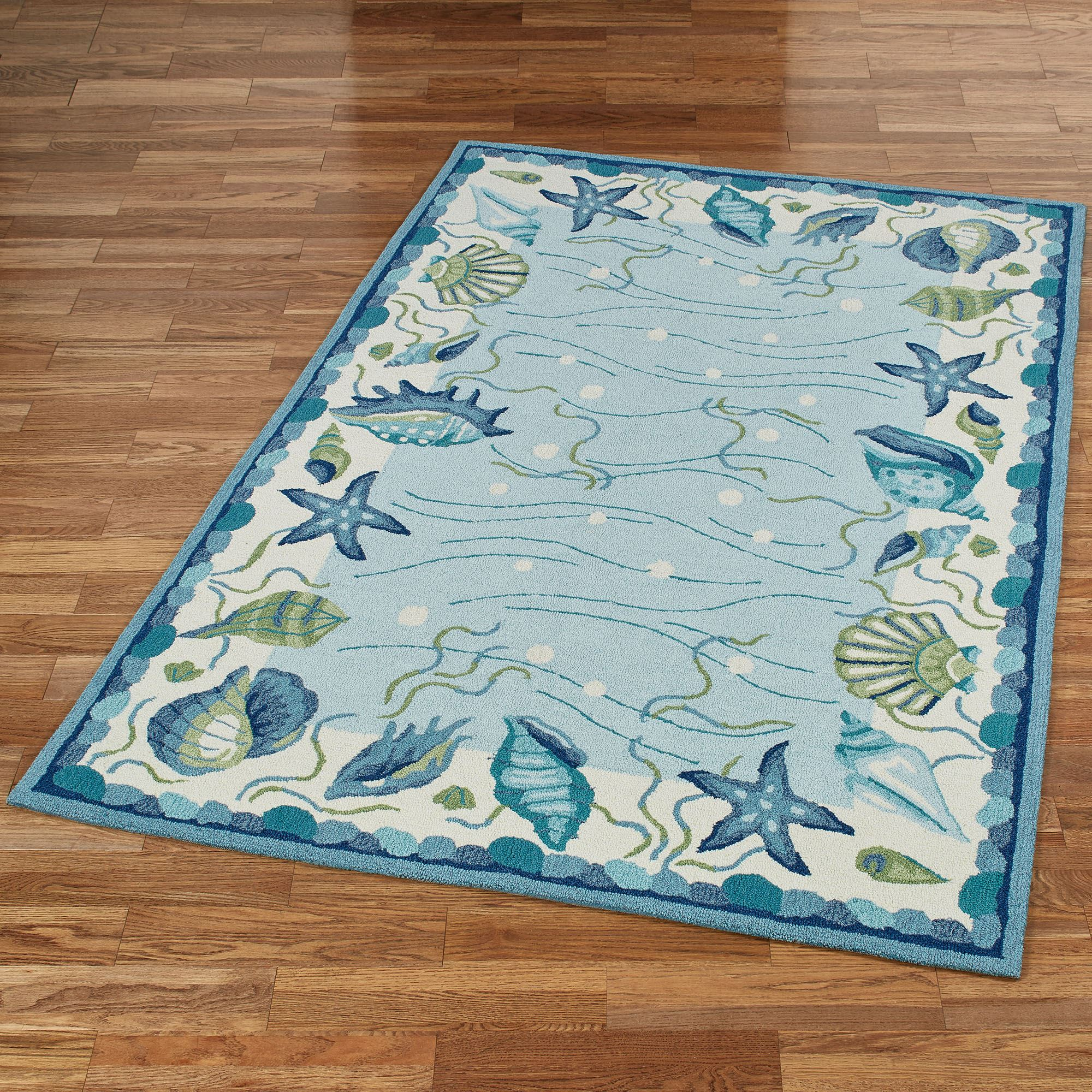 in ethan pin turquoise luster this damask of made rug hand combines from area weave allen art jacquard by india the with variegated silk