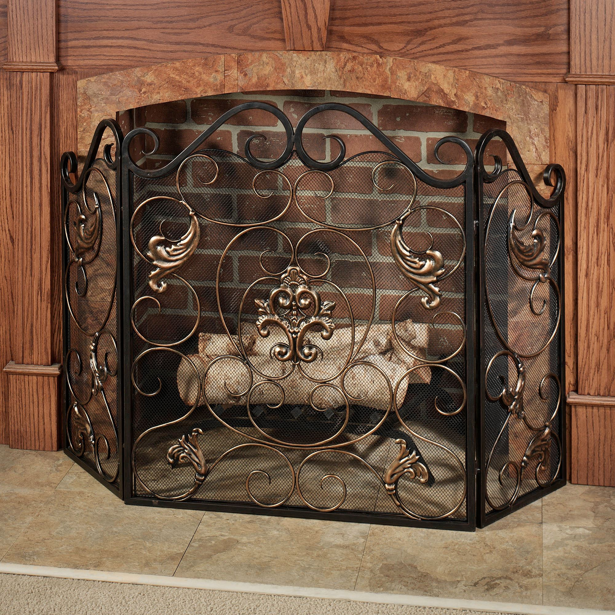 Add to your decor with the charming Taleisin Scroll Metal Fireplace Screen. This exquisite metal fireplace screen features a traditional swirling scroll...