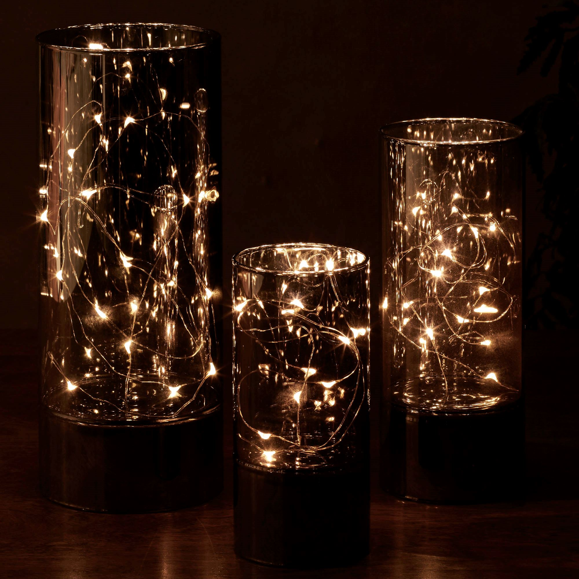 Led lighted smoke glass hurricane set led lighted smoke glass hurricanes black set of three floridaeventfo Gallery